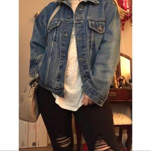 Oversized 80s style distressed denim/jean jacket